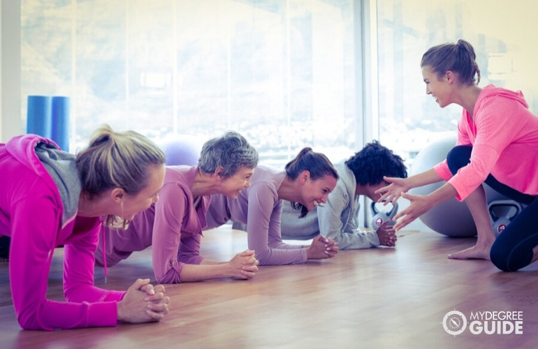 Personal Fitness trainer giving instructions during a class