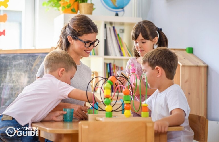 Early Childhood Education Teacher assisting her students in class