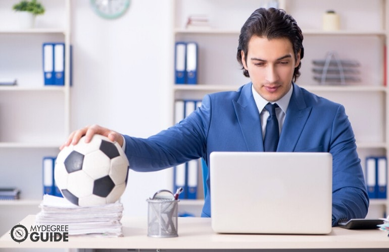 sports manager working in the office