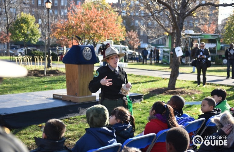 Park Ranger explaining park rules to children