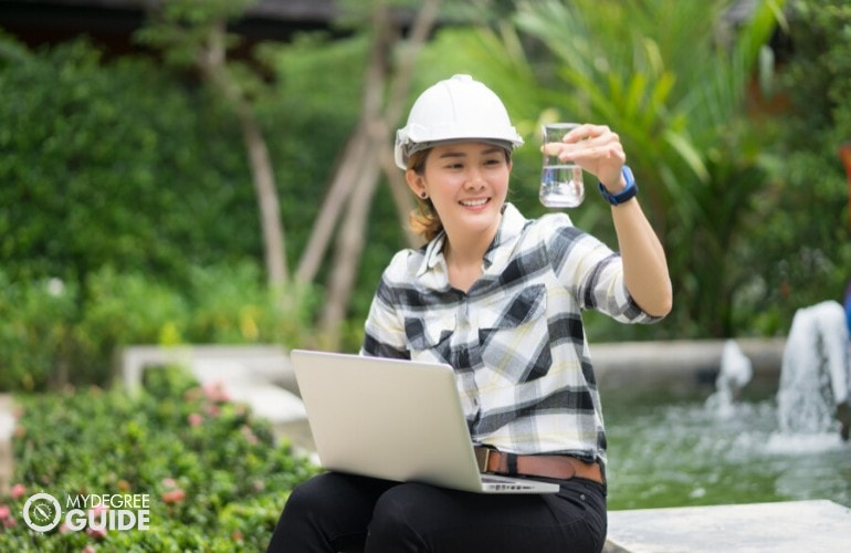 Environmental Engineer checking the water from a pond