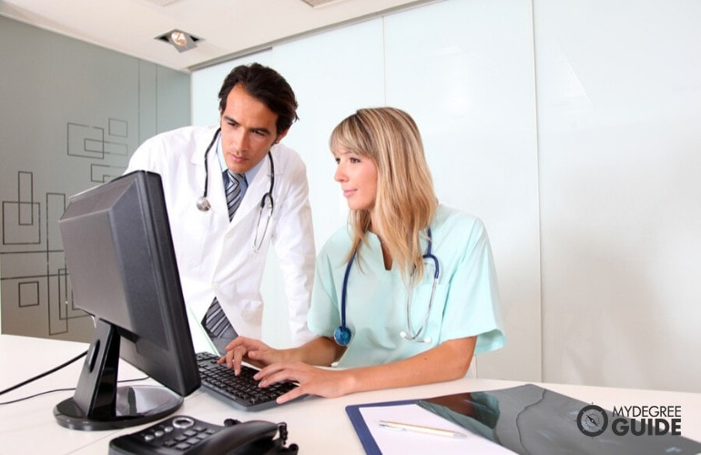 Health Information Management Supervisor checking his staff