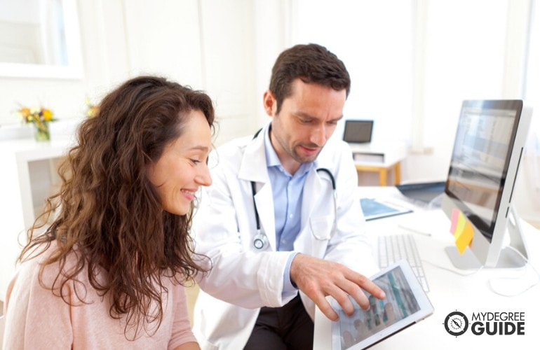 Doctor showing the digital record of his patient