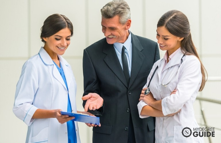 Healthcare Administrator talking to doctors in a hospital