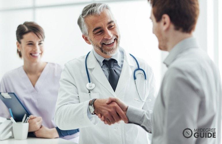 hospital administrator greeting doctors in hospital