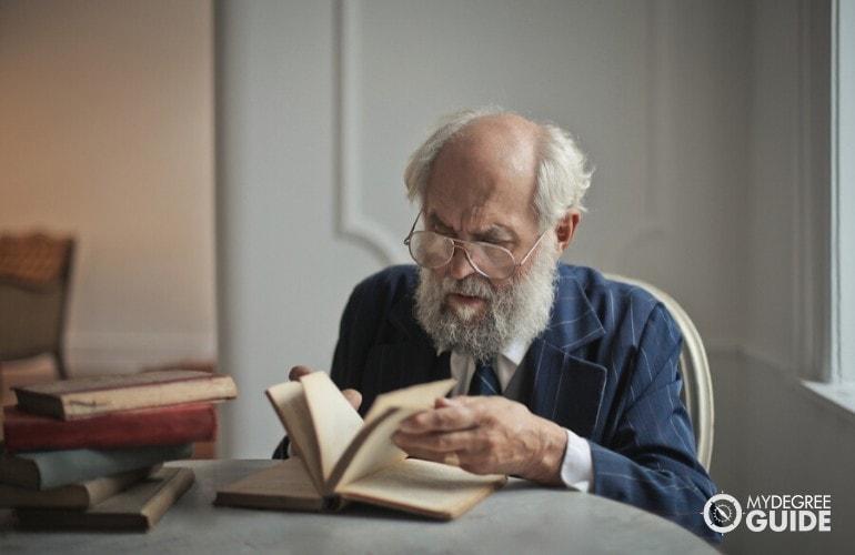 Historian reading a book