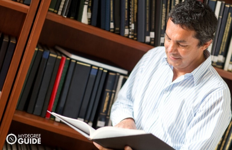 Academic Researcher researching in a library
