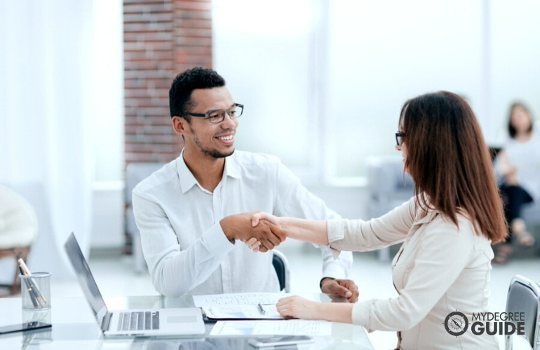 human resource manager shaking hands of a colleague