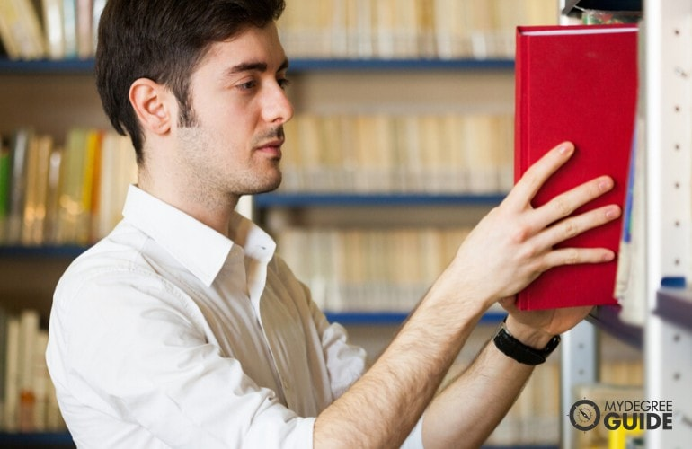 History Major student searching a book in the library