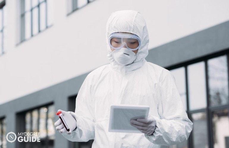 epidemiologist examining a blood sample
