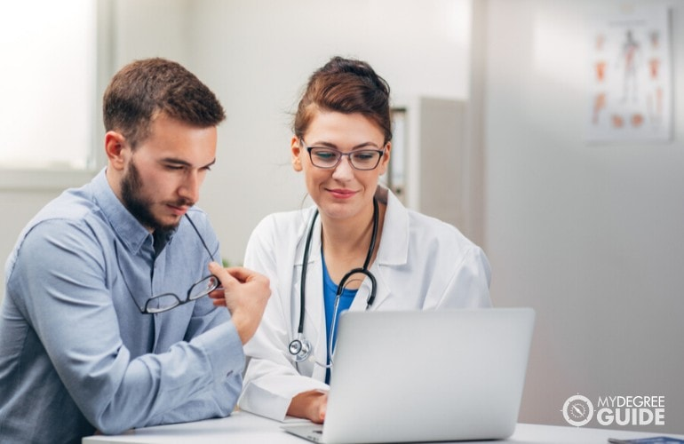 health information manager talking to a doctor