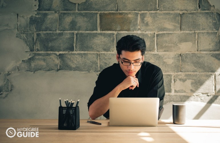 Business Intelligence student studying at home