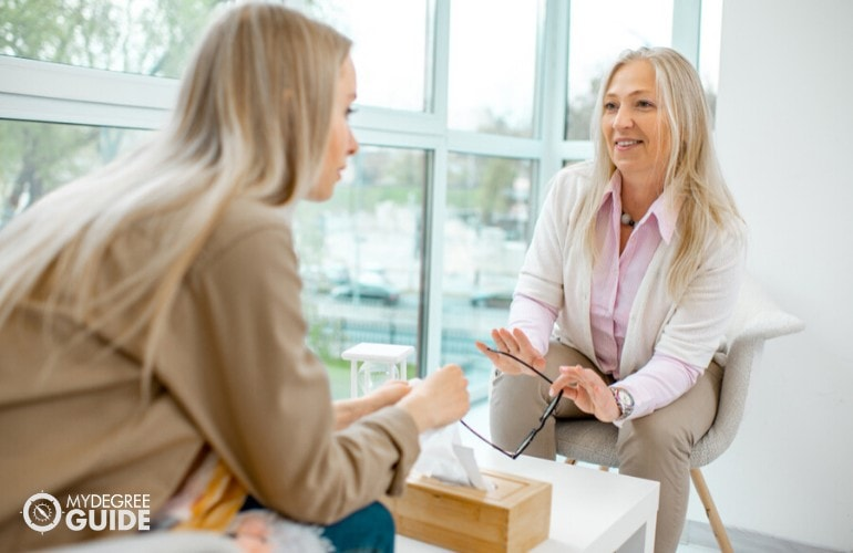 Psychologist listening to her patient during therapy