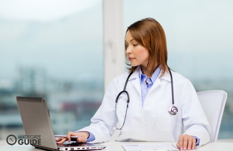 Registered Health Information Administrator working on her laptop