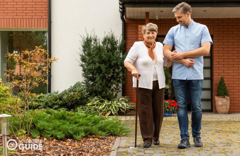 social worker assisting an elderly woman