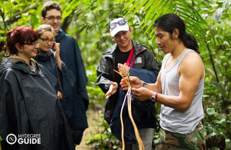 Tour Guide explaining a plant to the tourists