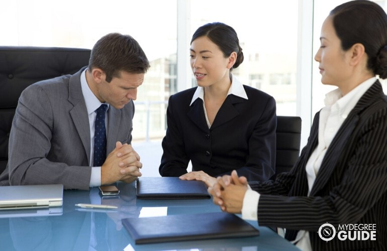 Translator helping her client during a business meeting