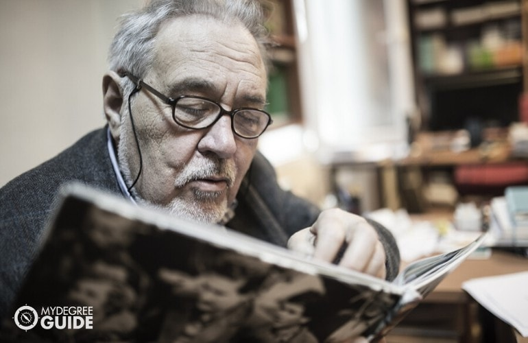 Historian reading a book in his office