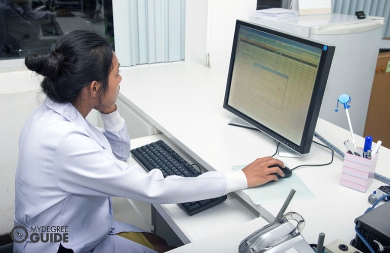 Medical coder working on her computer