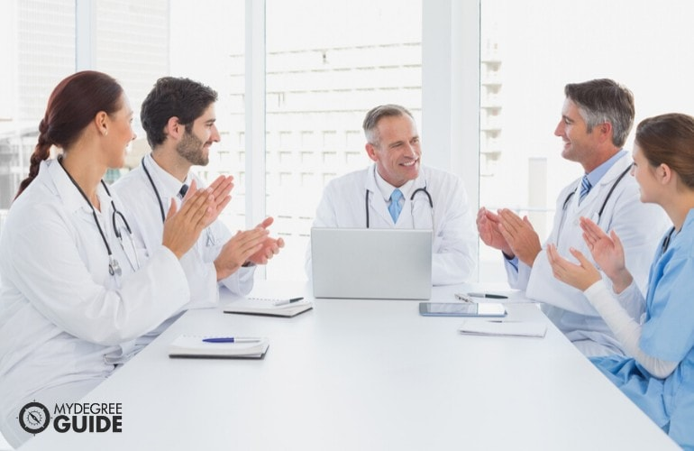 Healthcare Administrator meeting with his staff