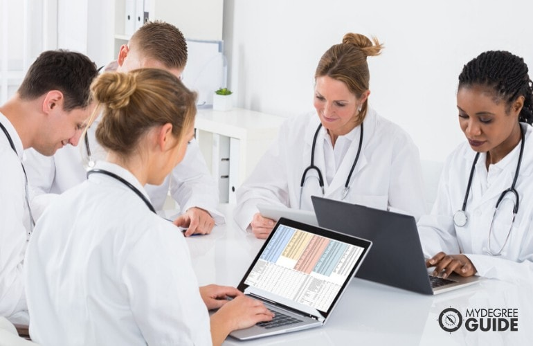 Health Informatics Managers in a meeting