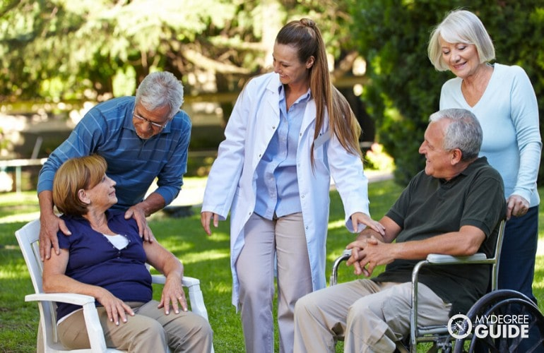 nursing home administrator talking with patients