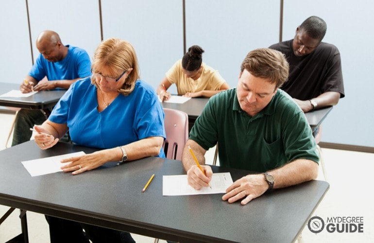 people taking an exam in a testing center