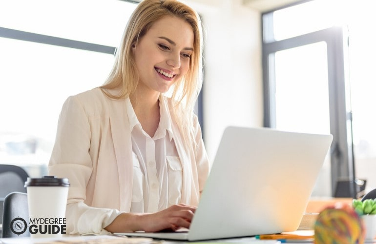 Organizational Leadership Degree student studying on her laptop