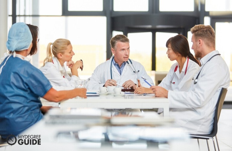 Hospital's Director of Operations having a meeting with his colleagues