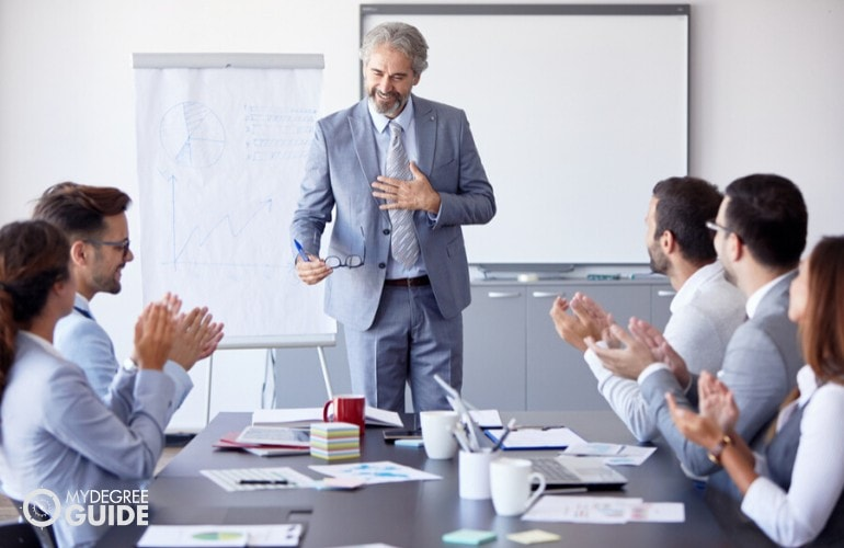 Chief Operating Officer meeting with his employees