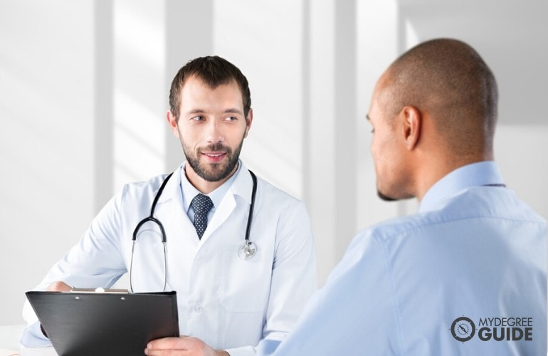 Healthcare Consultant talking to a patient