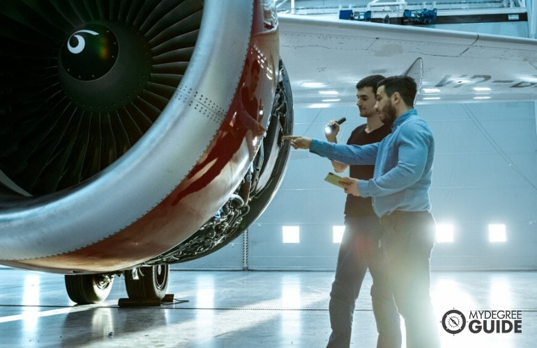 Aerospace Engineers checking the aircraft's engine