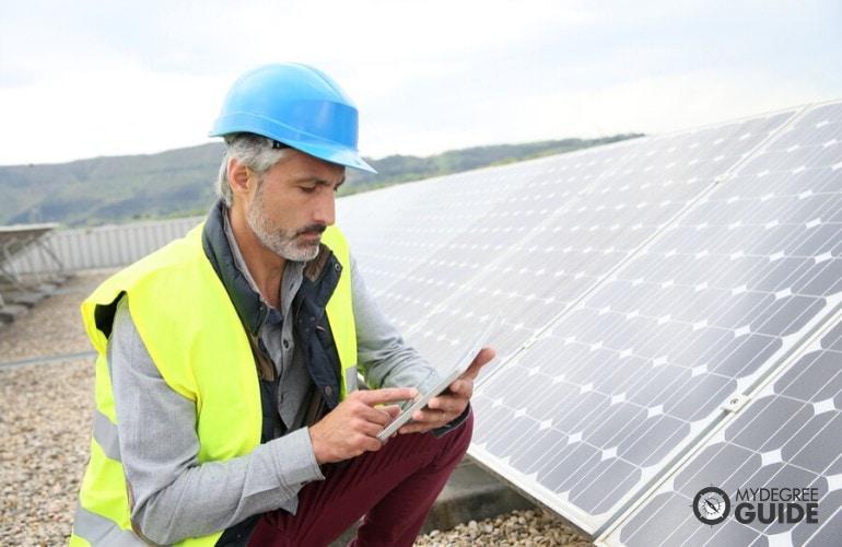 Environmental Engineer inspecting solar panels