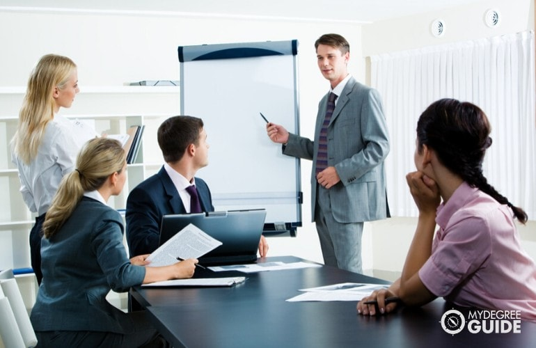 Human Resources Director meeting with his colleagues