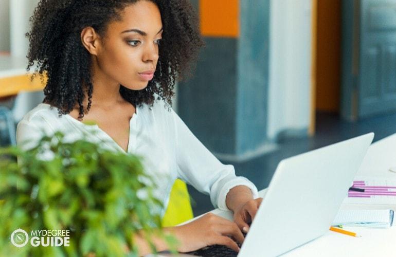 Organizational Leadership student studying on her laptop