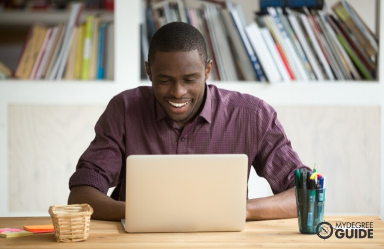 Master's in Organizational Leadership Degree student studying at home