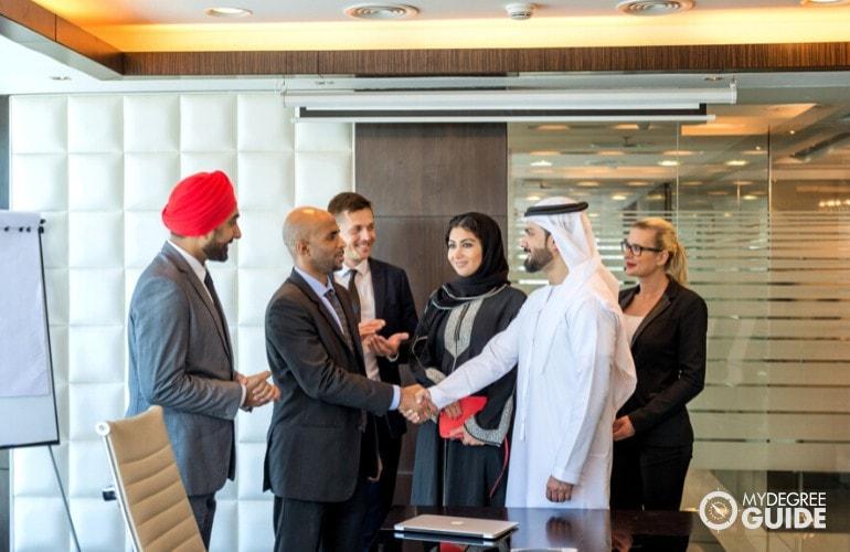 Organizational Development Manager meeting with international business partners