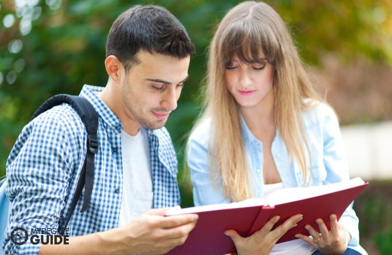Public Administration Degree students reading a book together