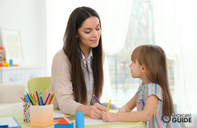 Mental Health therapist talking to a child who is a victim of abuse