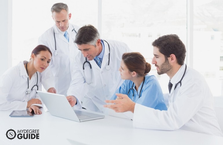 Healthcare Administrators checking online files during a meeting