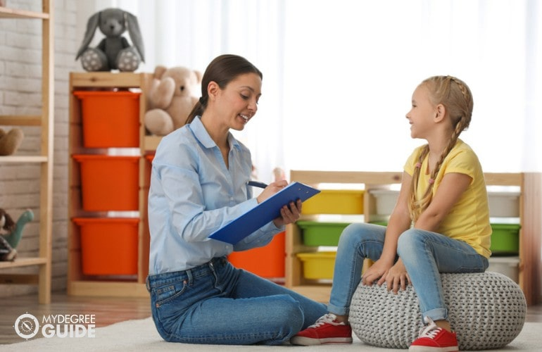 School Counselor talking to a young child
