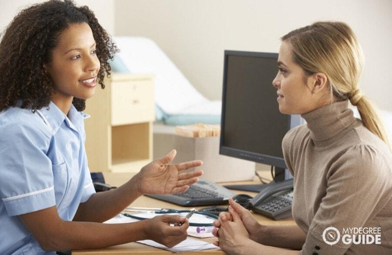 nurse practitioner diagnosing a patient