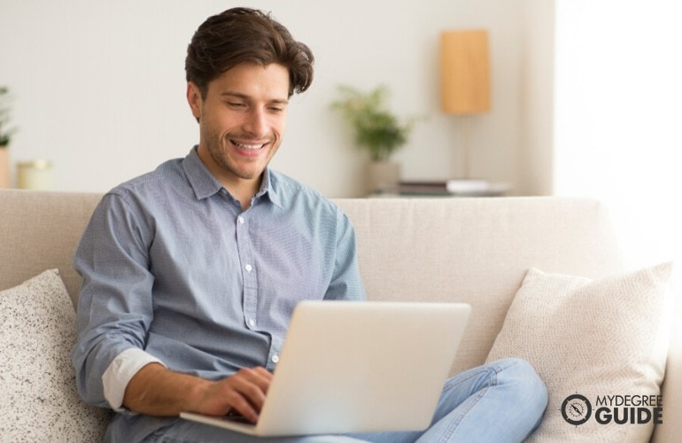 Masters in Marriage and Family Therapy student studying online at home