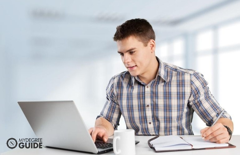 Bachelors Degree in History student studying online at home