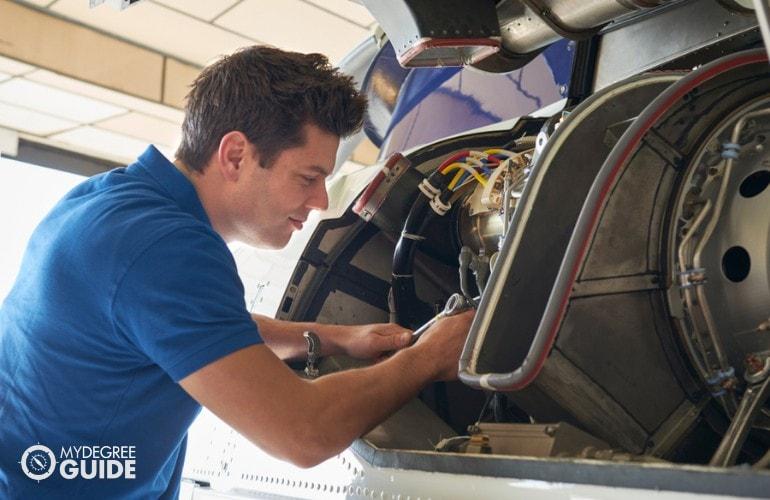 Mechanical Engineer working on an aircraft