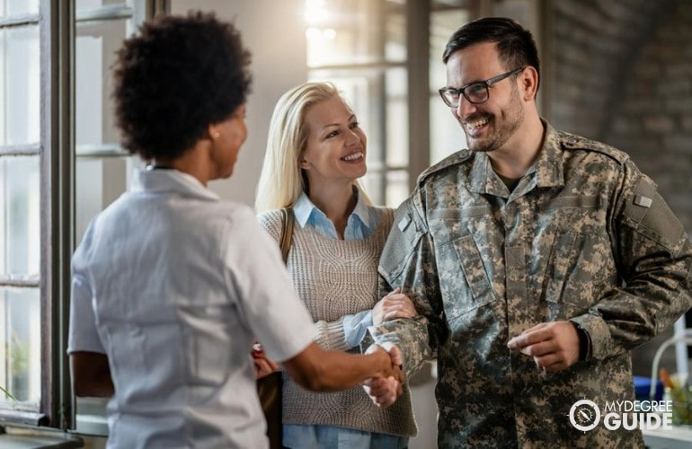 Military personnel visiting his Alma mater with his wife