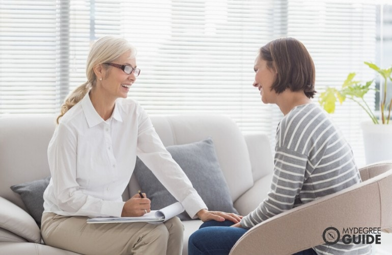 Mental Health Counselor happily talking to her patient