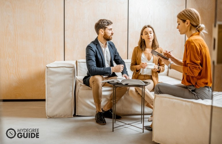 Marriage Therapist interviewing a couple during therapy