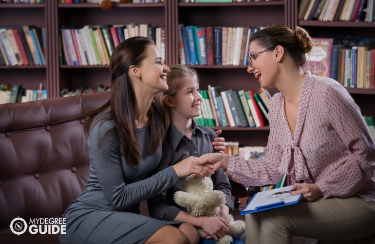 School Counselor talking to a student with her mother