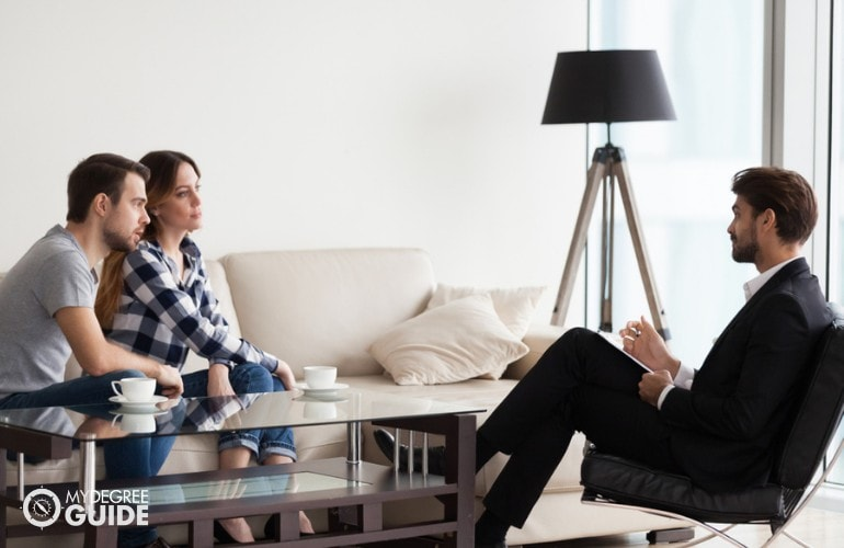 married couple having a consultation with a therapist